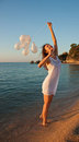 Happy brunette girl with white balloons Stock Image