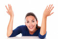 Happy brunette with hands gesturing excitement while looking at you in white background Stock Image