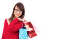 Happy brunette holding shopping bags on white background Stock Photos