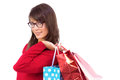 Happy brunette holding shopping bags on white background Royalty Free Stock Image