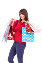 Happy brunette holding shopping bags on white background Royalty Free Stock Images