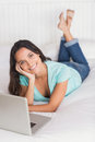 Happy brunette using her laptop Royalty Free Stock Photo