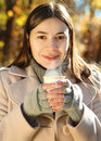 Happy brunette woman drinking coffee outdoors Royalty Free Stock Photo