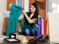 Happy brunette woman looking purchases at home Stock Photos