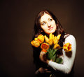 Happy brunette  woman with tulips Royalty Free Stock Image