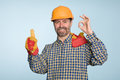 Happy builder with thumbs up gesture Stock Image