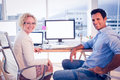 Happy business colleagues smiling at the camera in office Royalty Free Stock Photo