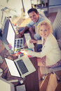 Happy business colleagues smiling at the camera upper view of Royalty Free Stock Image
