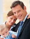 Happy business couple with their cute baby Stock Photography
