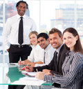 Happy business leader with his team in a meeting Royalty Free Stock Image