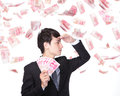 Happy business man hold china money renminbi under a rain isolated over a white background asian model Royalty Free Stock Photography