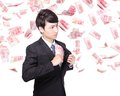 Happy business man hold china money renminbi under a rain isolated over a white background asian model Stock Image