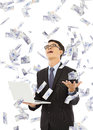 Happy business man holding a laptop and catching money with white background Stock Images