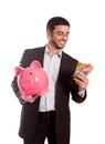 Happy business man holding piggy bank with australian dollars vertical portrait of a wearing a suit a and aud thinking about Royalty Free Stock Photos