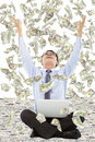 Happy business man raise hands to grab money Royalty Free Stock Photo