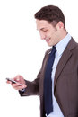 Happy business man reading an SMS Royalty Free Stock Photo
