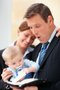 Happy business man standing with his wife and baby Royalty Free Stock Photo