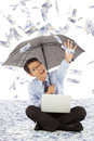 Happy business man stretch his hand to grab money from rain Royalty Free Stock Images