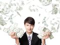 Happy business man with us money earned dollar bills under a rain isolated over a white background asian model Royalty Free Stock Photo