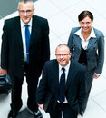 Happy business men and woman standing together Royalty Free Stock Images