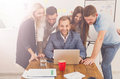 Happy business people team together with laptop in office Royalty Free Stock Photo