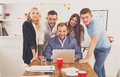 Happy business people team together near laptop in office Royalty Free Stock Photo