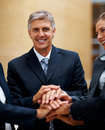 Happy business people with their hands together Royalty Free Stock Photo