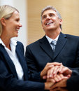 Happy business people with their hands together Stock Photo