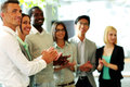 Happy business team applauding Royalty Free Stock Photo
