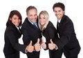 Happy business team celebrating a success with thumbs up on white background Stock Image