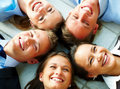 Happy business team lying down in a circle Stock Image