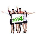 Happy business team showing the new year 2014 Royalty Free Stock Photo