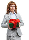 Happy business woman with Christmas gift Stock Photo