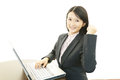 Happy business woman the female office worker who poses happily Royalty Free Stock Photo