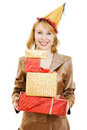 Happy business woman in a festive hat with gifts Stock Photos