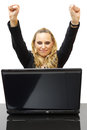Happy business woman with hands up in office a Royalty Free Stock Photography