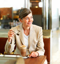Happy business woman on her lunch break Royalty Free Stock Image
