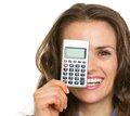 Happy business woman holding calculator in front of face Royalty Free Stock Photo