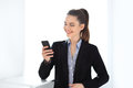 Happy business woman holding mobile phone Royalty Free Stock Photo