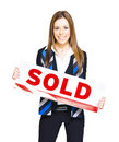Happy Business Woman Holding Sold Sign Stock Image