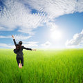 Happy business woman jumping in green field  Royalty Free Stock Photo