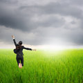 Happy business woman jumping in green rice field  Royalty Free Stock Images