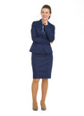 Happy business woman looking on copy space full length portrait of Royalty Free Stock Photography