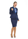 Happy business woman making fist pump gesture full length portrait of Royalty Free Stock Photo