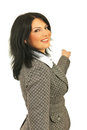 Happy business woman pointing back Stock Images