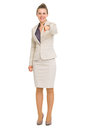 Happy business woman pointing in camera full length portrait of Royalty Free Stock Photography