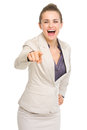 Happy business woman pointing in camera isolated on white Stock Photos