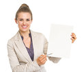 Happy business woman pointing with pen on blank paper sheet Royalty Free Stock Photo
