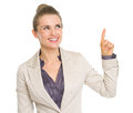 Happy business woman pointing up on copy space isolated white Royalty Free Stock Photo