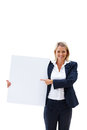 A happy business woman pointing at white billboard Royalty Free Stock Images